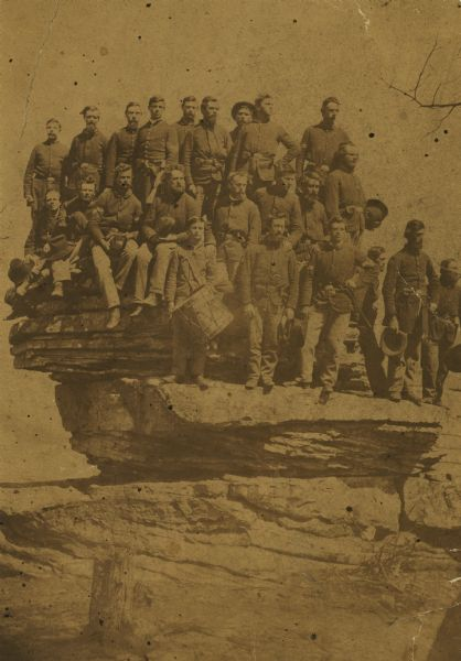 Company D, Twenty-first Wisconsin Volunteer Infantry. Top row (left to right): John Buboltz, Spencer Orlup, J. Henry Otto, Lyman C. Wait, Andrew Jackson, William W. Wood, Joseph D. Holden, Charles Lymer, and Sylvester Greeley; second row, seated: Charles Buck, Miles Hoskins, George Ranson, Nelson B. Draper, Miles H. Fenno, Lewis H. Sykes, and James P. Walker, end of second row, standing: John Dey: front row: Harold Galpin, Jacob W. Rexford, August Pierrelee, Maurice R. Grunert, Ephriam Walker, and Charles Buckholz.