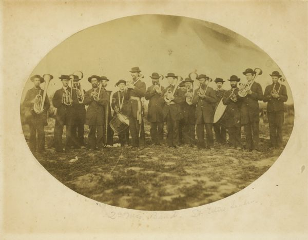 The brass band of the 2nd Wisconsin Infantry.  In the past the leader in the picture was identified as Hazard W. Titus, but Titus did not become leader until May 1862 when the band became much smaller.  Deemed too expensive, the War Department began discharging military bands in November, 1861.  It is more likely the leader shown here is band's first leader, Homer S. Chandler, who resigned in October, 1861.