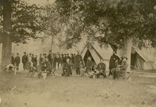 The headquarters camp and officers of the 16th Wisconsin Volunteer Infantry in Tennessee. The officer seated on the far right is thought to be Cassius Fairchild, who entered the war as a major and was promoted to colonel in March, 1864.