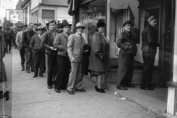 Members of the United Automobile Workers union, Local 75, line up outside the local's headquarters, 308 E. Center Street, to vote on delegates to the union's convention. Local 75 represented workers at the Seaman Body Corp., a subsidiary of Nash Motors.