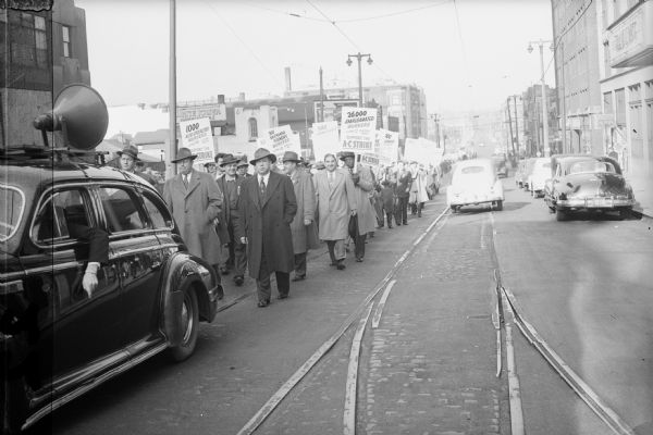 Striking Allis Chalmbers workers and CIO supporters on parade in 1946.  In later years it was common suggested that the Communist-dominated Milwaukee CIO had contributed to the election of Senator Joseph R. McCarthy because of their opposition to Senator Robert La Follette's anti-Communist stance.  This historical irony is now generally discounted by McCarthy biographers.