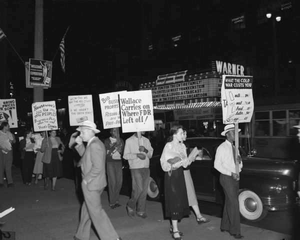 One of the many demonstrations organized by the People's Progressive Party in Milwaukee to fight the ever-rising cost of living. The campaign includes the possibility of a week's boycott on meat and calls for establishment of city-run milk distributions, among other features.  A number of such demonstrations have taken place in different parts of the city. This one was on Wisconsin Avenue in the heart of the downtown area. - Wisconsin CIO News