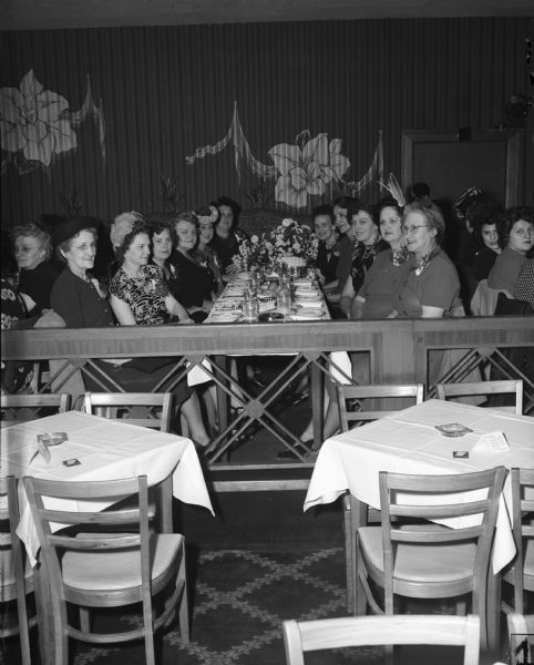 Officers of Auxiliary No. 2, United Automobile Workers (Seaman Body Company) celebrate their thirteenth anniversary at the Tic Toc Club.  Left to right: Katherine Meyer, vice-president; Jeanetta Kim, recording-secretary; Mary Schmidt, sergeant-at-arms; Martha Parbs, trustee; Ann Speth, past president; Eleanor Borowski, planning committee chairman; Henrietta Karrer, president; Ann Steffes, guide; Clementine Steffes, financial secretary; Loraine Selky, trustee; and Teresa Goes, trustee.