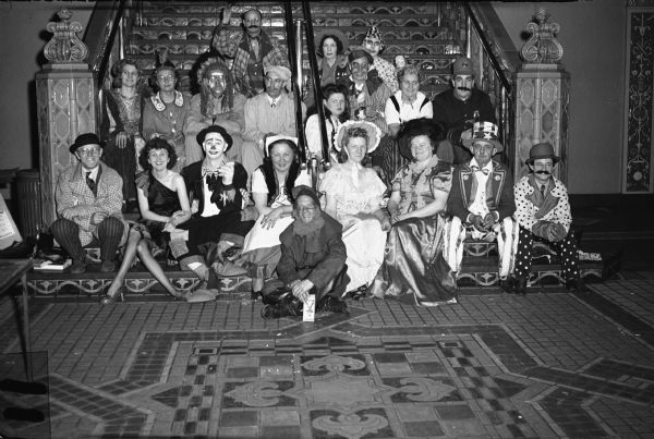 Members of Local 1114, United Steelworkers of America (Harnischfeger Corporation) at a holiday costume party.