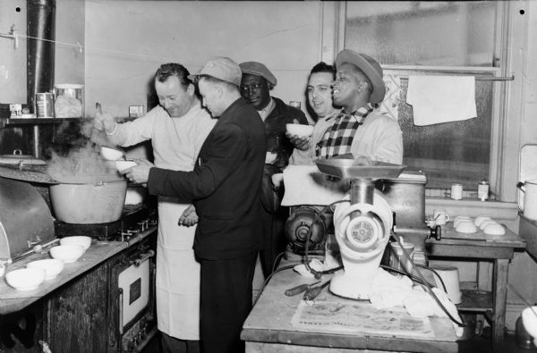Strike kitchen of Local 50, United Packinghouse Workers of America (Plankinton Packing Company).  Left to right: Al Herold (chef), Ernie Bernie, Jimmy Glover, Joe Catanese, and Henry Cabell.  The United Packinghouse Workers had one of best records of any union on racial issues. In 1948, 83% of UPWA locals had African American stewards, and 73% had African Americans on their executive boards.