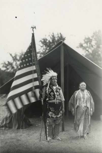 Chief George Monegar of the Winnebago holding an United States flag.