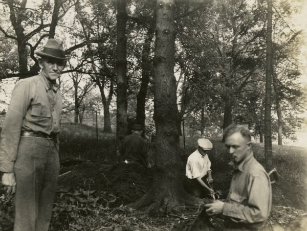Charles E. Brown (left), directs excavation of a goose effigy mound at the Willow Drive mound group on the University of Wisconsin-Madison campus.