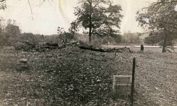 A linear burial mound and historic marker at the University Ridge mound group on the University of Wisconsin-Madison campus. The mound group was eventually destroyed by plowing, the creation of an experimental orchard, and the construction of the U.S. Forest Products lab.