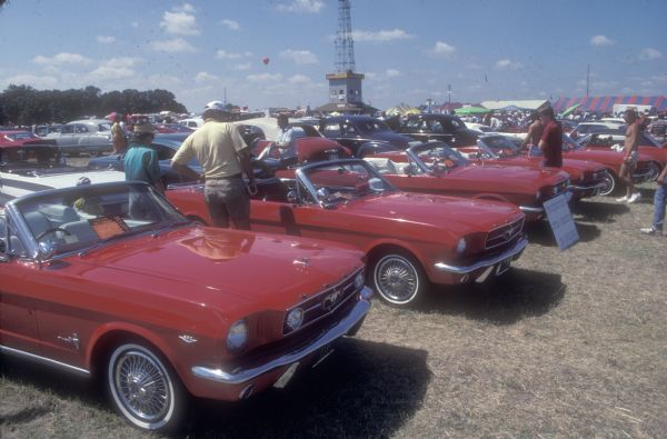Red Ford Mustangs are a center of attention at the 1989 Iola Old Car Show.