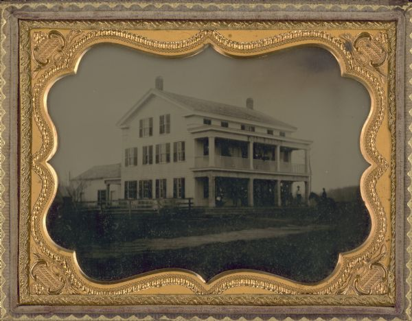 Ambrotype of the Wade House, a carriage inn located in Greenbush, also showing a section of the original plank road in the foreground.