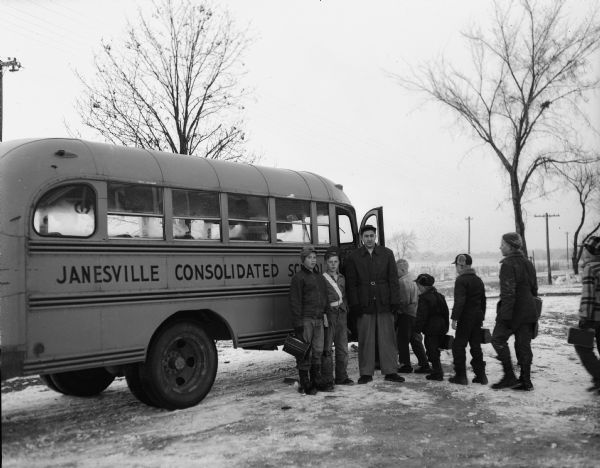 Rural Rock County students boarding a bus for the Janesville consolidated schools.