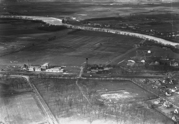 Aerial view of the Jones dairy farm, Fort Atkinson, in winter.  The Rock River is in the background.