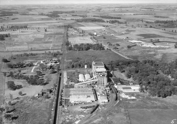 Aerial view of the Oscar Mayer meat packing plant, looking north, with the surrounding rural countryside.