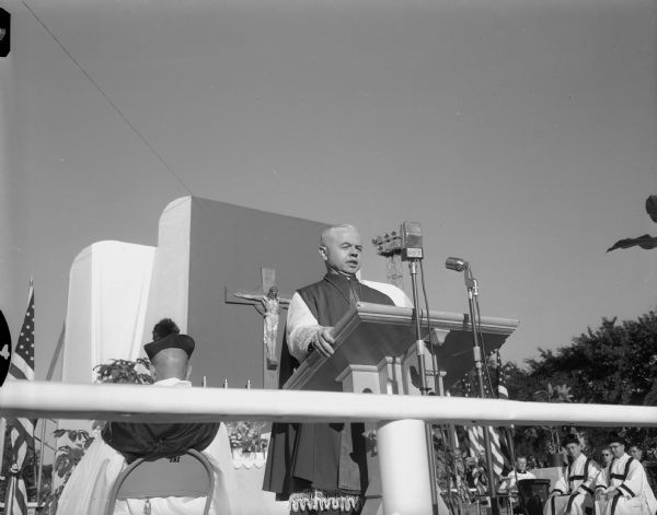 Archbishop Philip Pocock of Winnipeg preaching the sermon at the Confraternity of Christian Doctrine pontifical field mass held at Breese Stevens Field.