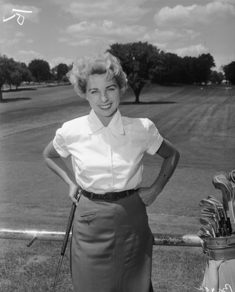 Unidentified woman golfer posed at the Maple Bluff Country Club.