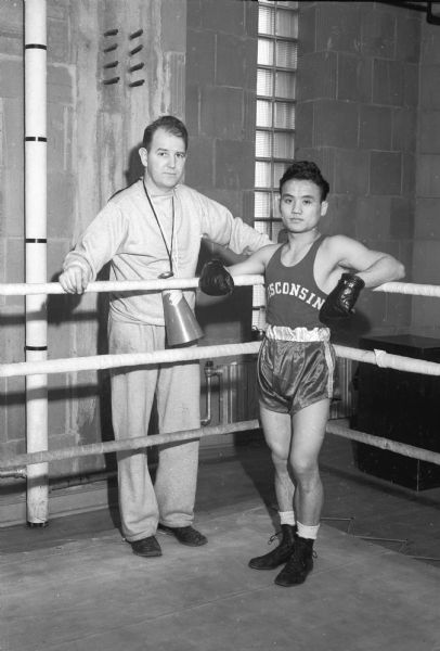 Japanese boxer, Dick Miyagawa, with University of Wisconsin boxing coach, John J. Walsh. Miyagawa was the national collegiate champion in 1942 when he competed for San Jose State. Later he boxed for the University of Wisconsin.
