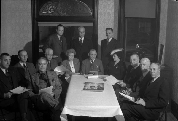 Workers for the Dane County chapter of the American Red Cross, (back row, left to right): W.H. Frederick, H.H. Kletzien, Arthur Towell; and (front row, left to right): Robert H. Gerry, Lawrence Larson, Leo Schlicht, Wallace W. Weaver, Lohra Davies, Louis Hirsig, June Wheeler, James R. Law, Louis Hanks, and Dr. Harold Bradley.