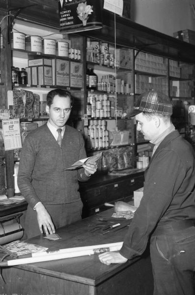 Alvan Rothermel, Glen Oak Hills, purchasing seed, labels and tools, for his Victory garden from Louis Schuster, manager of the L.L. Olds Seed Company, 720 Williamson Street.