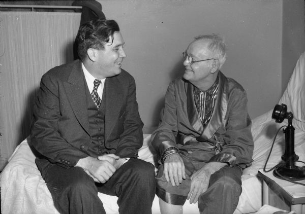 Wendell Willkie visits with Aaron Martin Brayton, retired editor of the <i>Wisconsin State Journal</i>, on his bed in a local hospital room during Willkie's 1944 campaign for the Republican Presidential nomination.