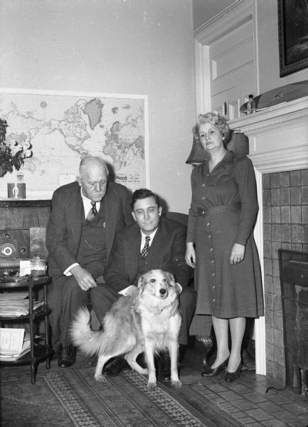 Wendell Willkie with the Governor and Mrs. Walter Goodland and their dog in the Governor's residence during Willkie's 1944 Presidential campaign visit to Wisconsin.