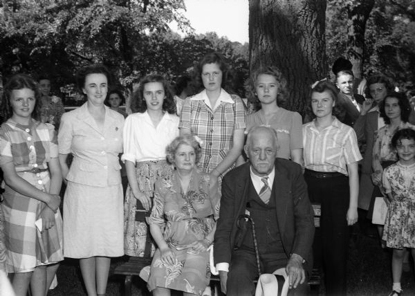 Group portrait of Governor and Mrs. Walter S. Goodland at the Junior Red Cross picnic with new and retiring officers. From left to right, Mrs. Gertrude Anderson, Ruth Mary Noland, Katherine Knaplund, Marion Miller, and Janice Richardson.