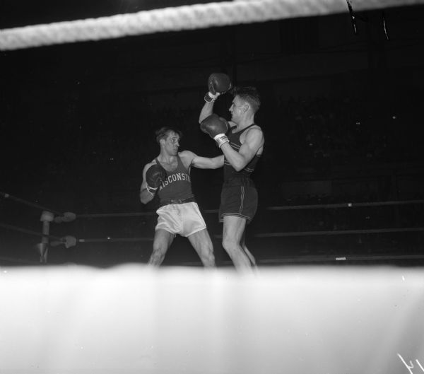 University of Wisconsin boxer Dan Dickinson (left) competing against Maryland's Ed Rieder at the National Collegiate Athletic Association national tournament at the University of Wisconsin-Madison Field House.