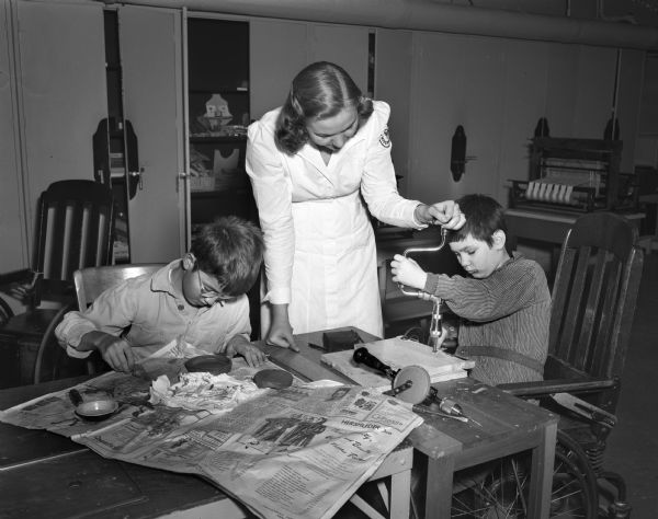 Two young male patients and an occupational therapist doing an activity at the Wisconsin Orthodpedic Hospital, 1415 Linden Drive.