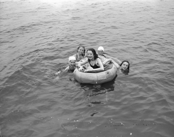 Camp Maria Olbrich, a YWCA camp on the north shore of Lake Mendota. Swimmers left to right: Beverly Ronge, Maxine Watson, Janet Hart, Kay Esch, and Elizabeth McCanse.