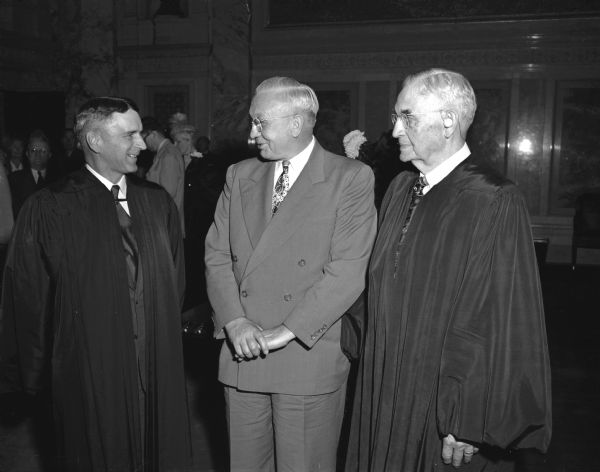 Group portrait of newly sworn-in Justice of the Supreme Court, Timothy Brown, at left, with Governor Oscar Rennebohm, center, and Chief Justice Marvin B. Rosenberry, at right.