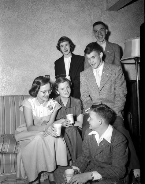 Teenage children of Nakoma Golf Club members hold paper cups as they enjoy their 'Junior Teen Spring Party.'  They are (clockwise): Sally Williamson, Nancy Lee, Nancy Beggs, Don Hahn, Don MacLeish and Bob Winston.