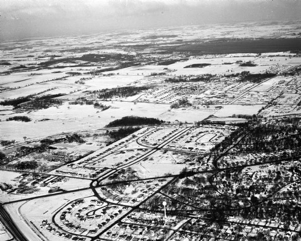Aerial view of Crawford Heights looking northwest across Nakoma Road. The photograph shows Nakoma Road, the West Beltline, Cherokee School, and Midvale Boulevard.