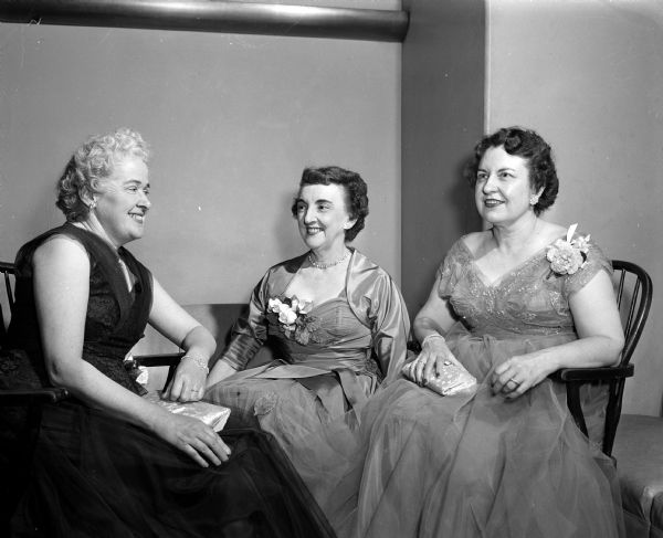 Rebecca Barton (left), Gertrude Anderson, and Constance Elvehjem attend the annual Matrix Banquet at Memorial Union.