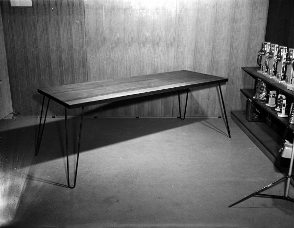 Modern table with metal legs. Designed/built by Collins(?).