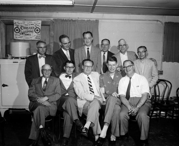 Group portrait of Madison Curling Club's new officers: left to right, front row: R.A. Black, J.H. Cottrell, Robert Mortenson, Don Timmerman, Dorsey Botham. Back row:  Stephen Resan, James Marshall, Don Knowles, Herbert Loucks, William Sherlock, Harland Hogan.