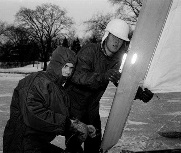 Portrait of David Rosten and Paul Krueger as they get ready for a ride in an iceboat.