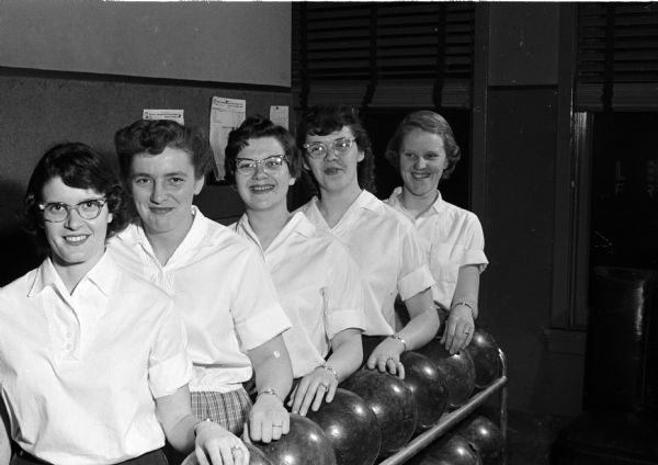 Portrait of five women of the Wisconsin State Journal bowling team.
