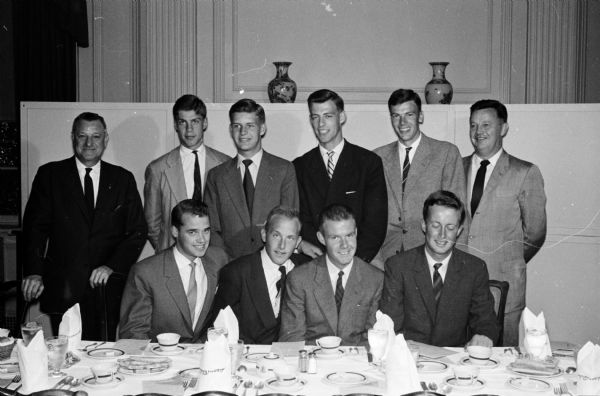 "Portrait of eight young ""Vikings"" who have come to Madison to be named as Thomas E. Brittingham Viking Scholar students at the University of Wisconsin. Seated left to right: Ralf Torngen, Helsinki, Finland; Helge Pedersen, Oslo, Norway; John Simonsen, Oslo and Frederik Eklof, Helsinki. Standing left to right: Bernhard Mautz, Madison; Staffan Berglund, Stockholm, Sweden; Niels Hoegh-Guldberg, Copenhagen, Denmark; Flemming Luttichau, Jutland, Denmark; Nils Frisk, Stockholm, Sweden and Henry Behnke, Madison. Thomas Brittingham Jr. died April 16, 1960.  The Brittingham Scholars program, founded in 1953 continued through 1962."