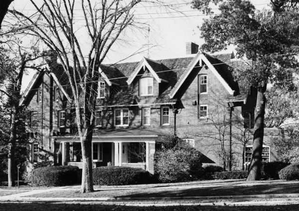 Exterior view of the John M. Olin House, 130 North Prospect Avenue, University Heights neighborhood. The house, which displays traditional Gothic lines and was designed by the architectural firm of Ferry & Clas, is the home of the chancellor of the University of Wisconsin-Madison.