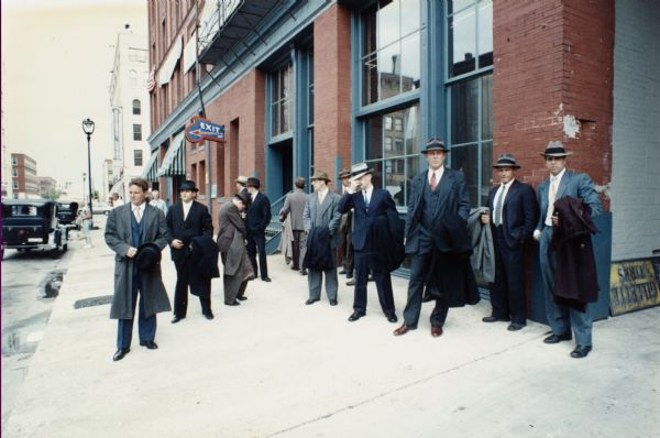 Costumed actors on location in Milwaukee during the filming of the made-for-TV movie, Dillinger.  Here, Milwaukee's historic Third Ward was being used to represent Depression-era Chicago.