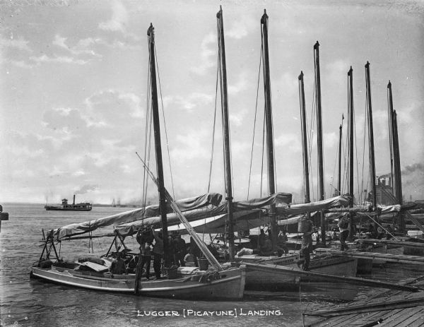 "Lugger (Picayune) Landing with sailboats and fishing boats in New Orleans, Louisiana. Text on photograph reads: ""Lugger [Picayue] Landing."""