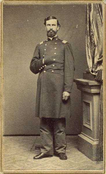 Standing portrait of Edward M. Bartlett, lieutenant colonel of the 30th Wisconsin, taken during the regiment's assignment at Camp Randall, 1862-1864.