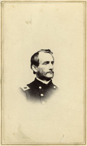 Vignetted carte-de-visite portrait of Colonel Lucius Fairchild in Madison, probably after the loss of his arm at Gettysburg.  This portrait can be dated as no later than mid-1864 because that is the time in which photographer Fuller left Madison.