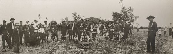 This photograph of Ho-Chunk powwow participants is a copy made by Van Schaick. From left to right are: John Hazen Hill (HaNaKah), William Hall (HunkKah), William Hinsley (Hensley), John Highsnake (HaukSheNeeKah), Thomas Thunder (HoonkHaGaKah), Chief  George Winneshiek (NauConChawNeeKah), George Greengrass (WauKeCooPeRayHeKah), John Davis (KaRoJoSepSkaKah), Luke (Duke) Snowball (NySaGaShiskKah), George Lonetree (HoonchXeDaKah), Henry Greencrow (CooNooZeeKah), William Hanson(HoonchHoNONikKah), David Goodvillage (WauHeTonChoEKah), George Monegar (EwaOnaGinKah), and Frank Winneshiek (WaConChaHoNoKah).