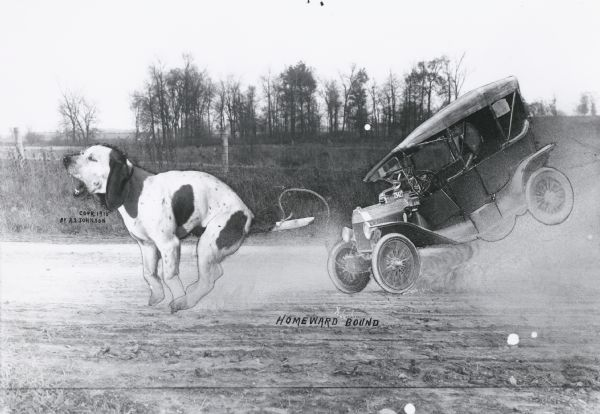 "Photomontage of a giant dog pulling an automobile across a landscape.  The dog is running, causing the car, which is tethered to the dog's tail by a rope, to kick up dust and fly into the air.  The words, ""Homeward Bound,"" are imprinted at the bottom of the image field.  There is no one sitting in the car."