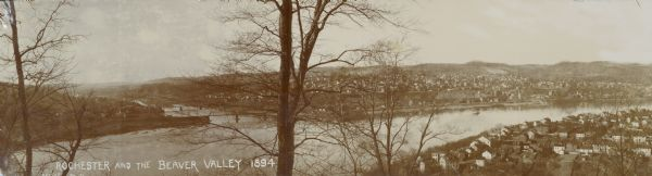 Panoramic view of Rochester and the Beaver Valley. Junction of the Beaver River and the Ohio River. Settlements and multiple bridges visible in the background.