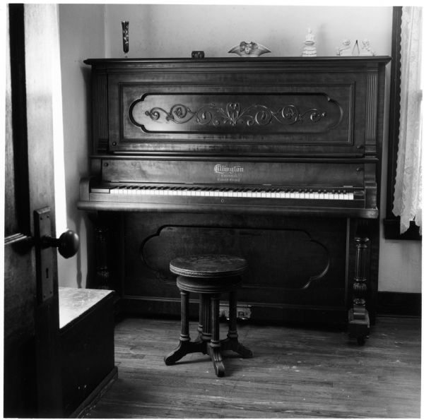 Piano in the front bedroom of the Quinney farmhouse.