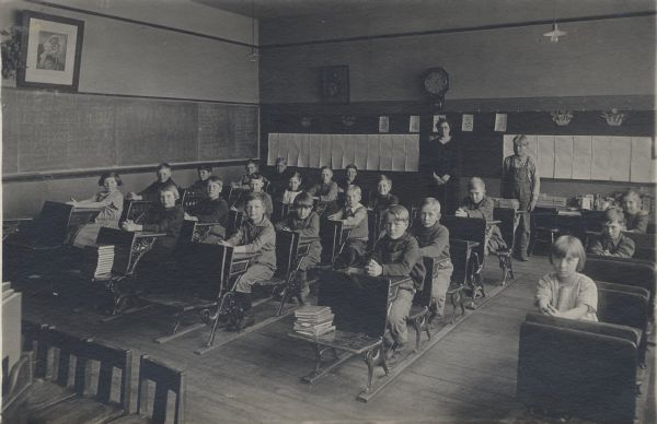 Students seated in a classroom in the Clear Lake School.  Gaylord Nelson, later governor of Wisconsin and a United States senator, is seated at the front of the third row from the left.