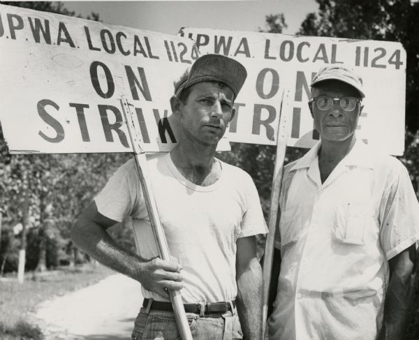 Two members of United Packinghouse Workers Local 1124 in New Orleans on strike against the Colonial Sugar Company.  They graphically symbolize the UPWA's dedication to organizing African Americans in the South. Although undated this image probably dates to the 1955 strike.