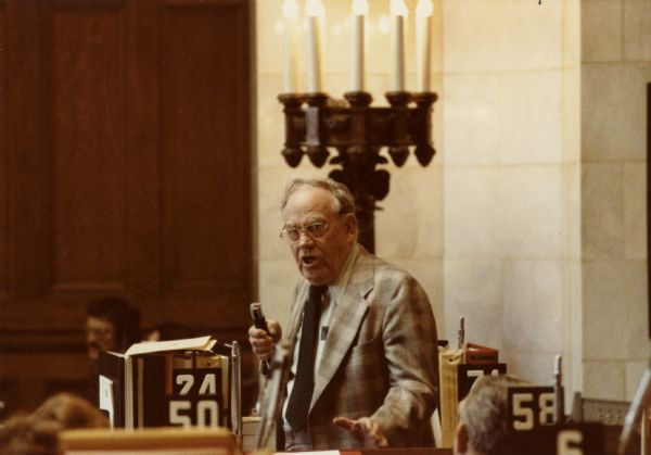 Informal portrait of Democratic Assemblyman Harvey Dueholm in the Wisconsin State Capitol.  A retired farmer, Dueholm was well-known for his humorous, down-to-earth wisdom.