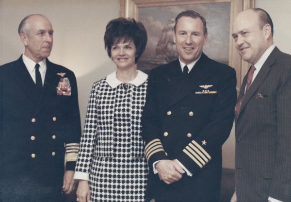 Secretary of Defense Melvin Laird of Wisconsin (on the far right) with astronaut James Lovell, a former student at the University of Wisconsin, and his wife Marilyn Gerlach Lovell of Milwaukee at the ceremony at which Lovell received the Navy Distinguished Service Medal. The medal was presented after the Apollo 8 flight. With them is Admiral Thomas Moorer, later chairman of the joint chiefs.